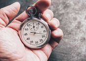 Main thumb cropped hand of person holding stopwatch royalty free image 923207256 1547465897