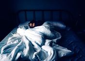 Main thumb woman sleeping in bed at night time royalty free image 1580223174